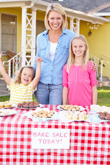 Mother And Children Running Charity Bake Sale