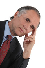 Businessman thinking alone