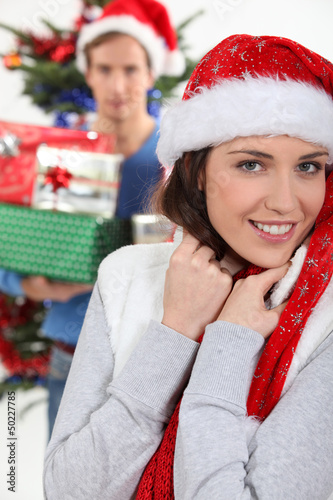 smiling girl wearing Christmas cap with boyfriend