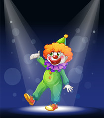 A clown at the center of the stage with a spotlight
