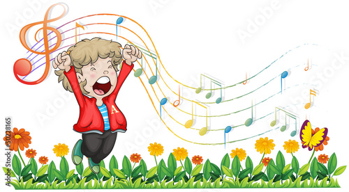 A boy singing at the garden