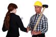 Tradesman shaking the hand of an engineer