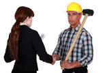 Tradesman shaking the hand of an engineer