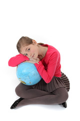 Girl hugging a globe