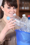 young woman sorting plastic bottles