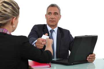 Woman giving a man her businesscard
