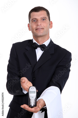 Waitor giving phone