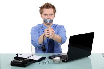 Man being held prisoner in the office