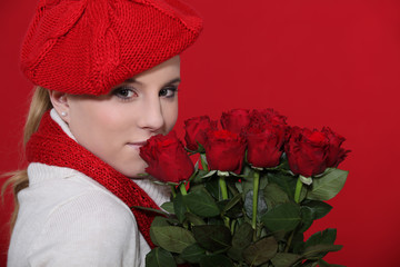 Woman holding bunch of red roses