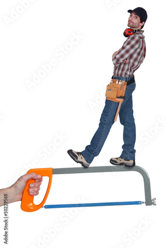 Worker standing on a saw