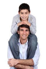 up on daddy's shoulder