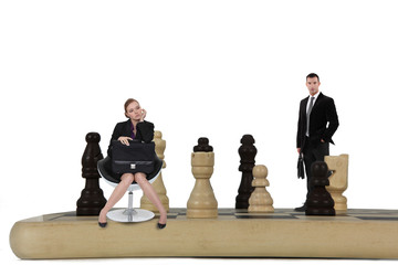 Two businesspeople on giant chessboard