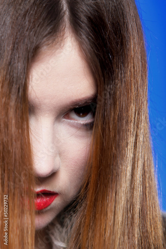 Woman shiny straight long hair and make-up