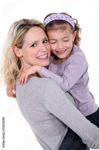 Woman hugging little girl