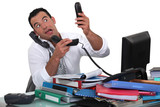 Office worker trying to answer multiple phones