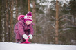Adorable girl sled from hill in park