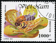stamp printed in Vietnam shows worker bee collecting honey