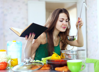 housewife cooking with ladle and cookbook
