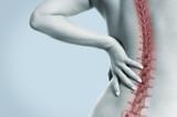 Fototapety Frau mit Schmerzen in der Wirbelsäule