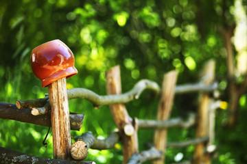 jar on wood fence