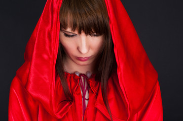 beautiful woman in a red robe humbly pray