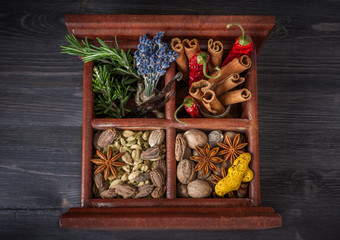 Spices and herbs in a wooden box