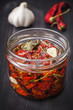 Dried cherry tomatoes with herbs and spices. Italian cuisine.