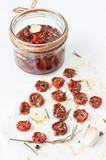Dried cherry tomatoes with herbs, spices and olive oil.