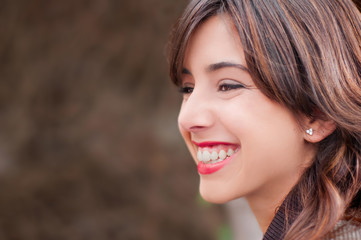 Profile portrait of a young woman smiling
