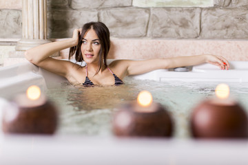 Young woman relaxing in the hot tub