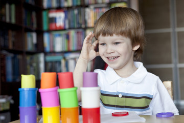 Little boy creating toys from playdough