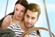 Loving couple embracing on sailing boat at summer