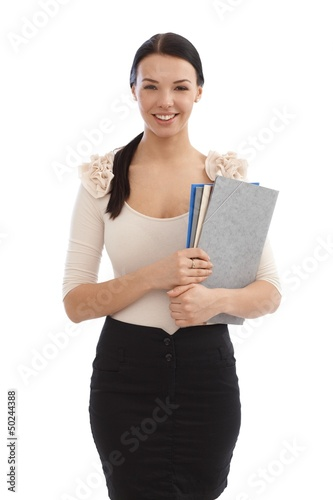 Smiling young secretary with files
