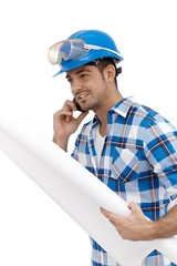 Young architect busy by working