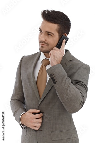 Young businessman on mobile