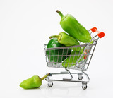 Green sweet pepper paprika  in shopping trolley on white backgro