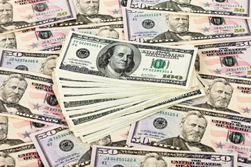 Heap of U.S. dollars on money background