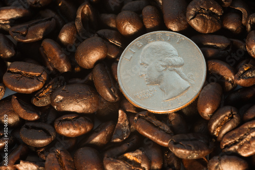 Coffee beans and quarter coin