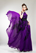 Beautiful fashion woman in violet long dress