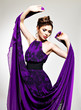 Beautiful fashion woman in purple long dress