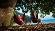 Pretty couple is laying on the hammocks