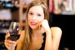 Beautiful woman holding a glass of wine