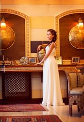 Aristocracy. Rich Lady standing. Orient Antique Interior