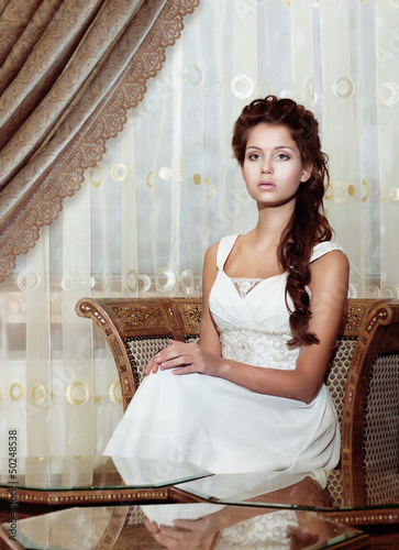 Femininity. Bride in Wedding Dress. Classic Romantic Interior