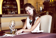 Luxury. Classy Romantic Woman in Restaurant. Expectancy