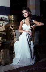 Wedding Style. Bride sitting in White Dress. Restaurant Interior