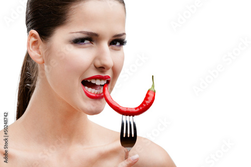 Woman with .hot pepper on fork, isolated on white