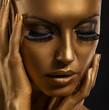 Gilt. Golden Woman's Face. Giled Make-up. Painted Skin