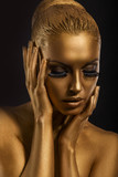 Face Art. Fantastic Gold Make Up. Stylized Colored Woman's Body
