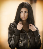 Beautiful woman wearing leather jacket